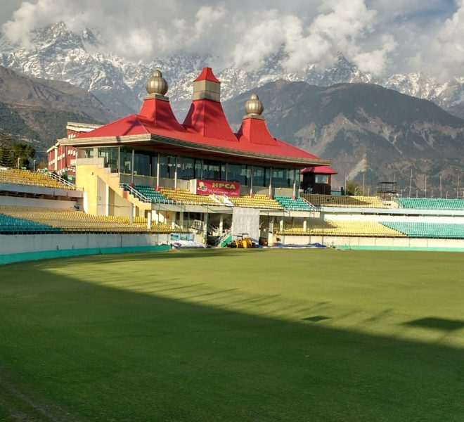 cricket stadium backround view with snow covered mountians